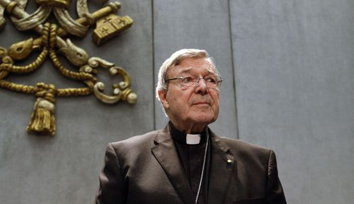 In this 2017 file photo, Cardinal George Pell prepares to make a statement, at the Vatican.