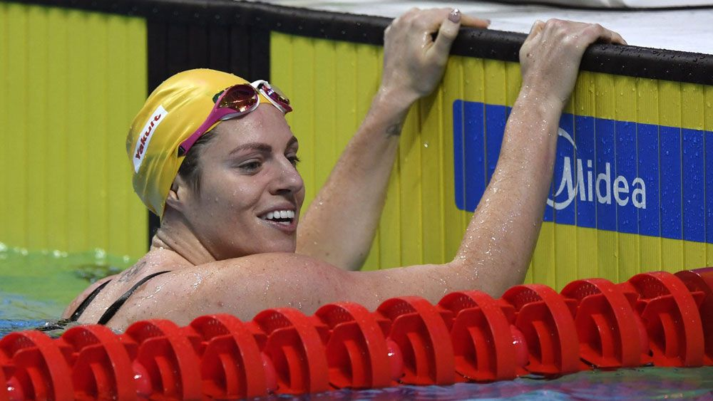 Aussie backstroker Emily Seebohm defies unwanted distraction to launch dual world titles defence