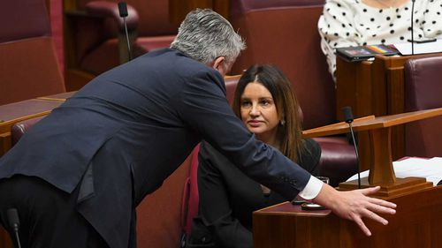 Jacqui Lambie speaks in the Senate with Mathias Cormann