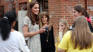 Catherine, Duchess of Cambridge at photography workshop for Action for Children, run by the Royal Photographic Society at Warren Park on June 25, 2019 in Kingston, England