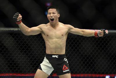 Ben Nguyen celebrates after defeating Ryan Benoit during their flyweight fight.