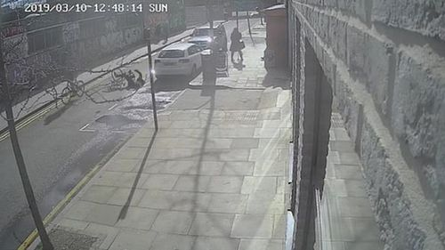 Police release CCTV footage of London cyclist being kicked off bike in Hackney.