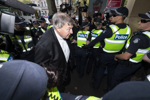 George Pell arrives at court to learn whether he will stand trial.