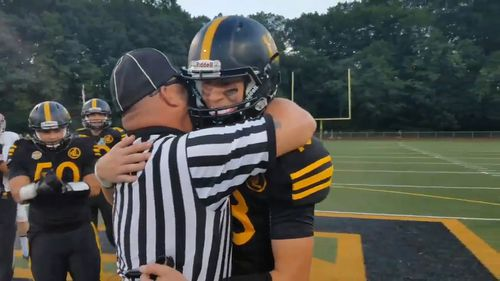 Master Sergeant Joe Egersheim surprised son Cole after appearing at his football game dressed as a referee. (Twitter/@mikemadera2)