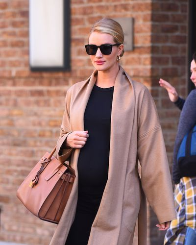 Rosie Huntington-Whiteley proves that a luxurious coat is the most important item every woman should have in her pregnancy wardrobe in the cooler months. Easy to throw on, comfortable, warm and an instant glamour elevator.