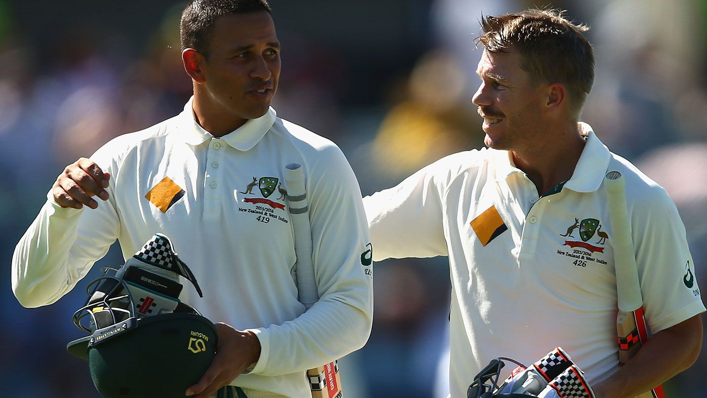 Usman Khawaja with David Warner.