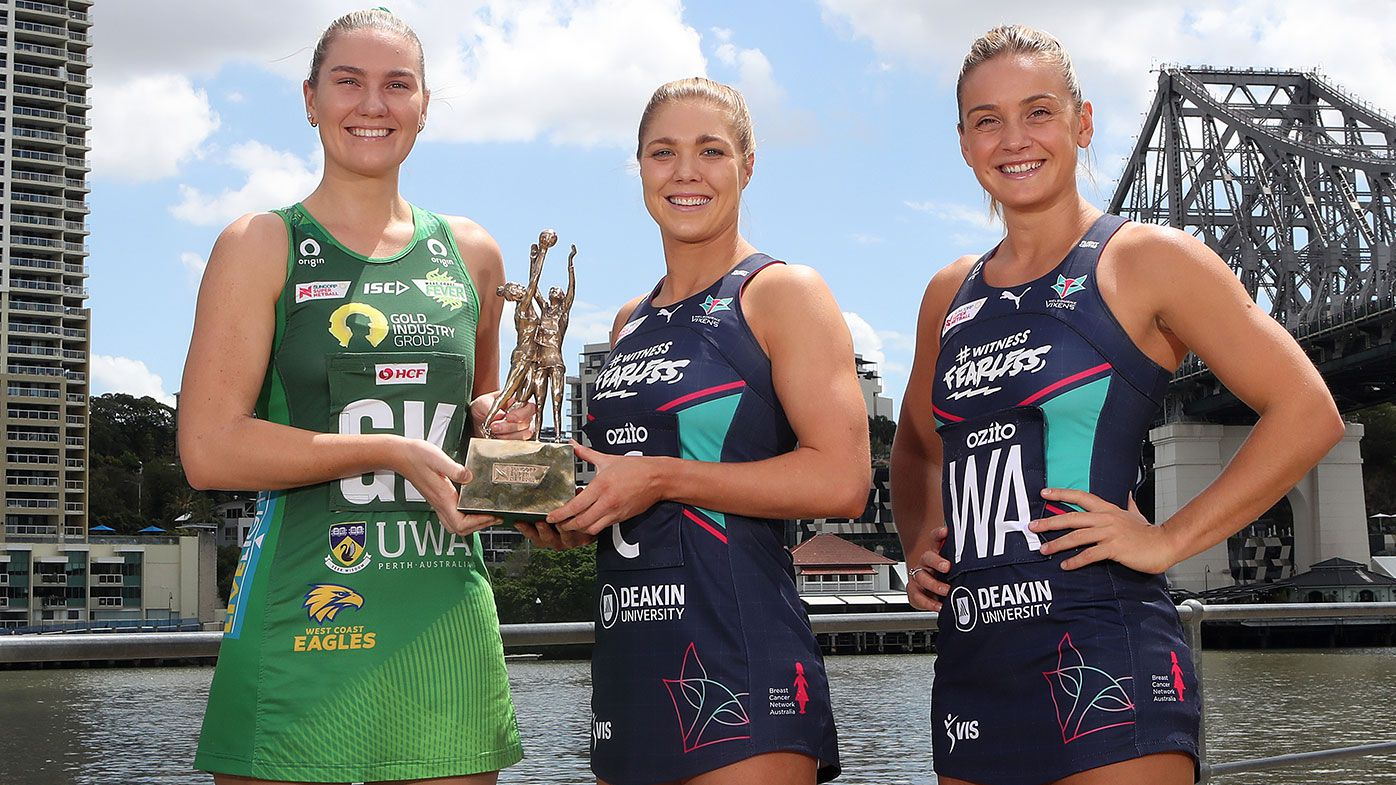 West Coast Fever captain Courtney Bruce and Melbourne Vixens co-captains Kate Moloney and Liz Watson pose with the Super Netball trophy