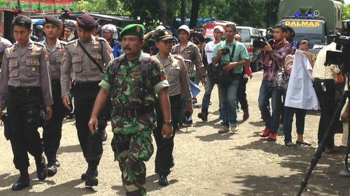 There is a heavy police presence in the Indonesian port of Cilacap. (9NEWS)