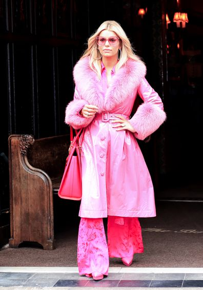 Jessica Simpson, wearing fur, hotel