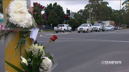 The girl's family were overcome with emotion when they visited the crash site, where they lit candles and said prayers. (9NEWS)