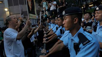 Pro-democracy activists hold photos of detained Nobel Peace Prize Laureate Liu Xiaobo during a protest in Hong Kong. (AAP)