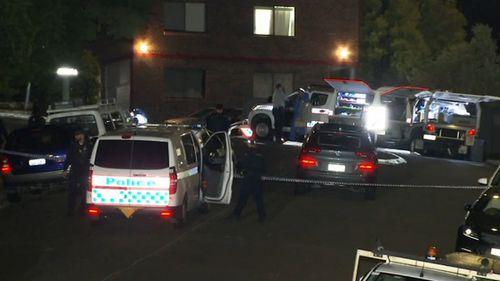 Police outside the Brisbane unit.