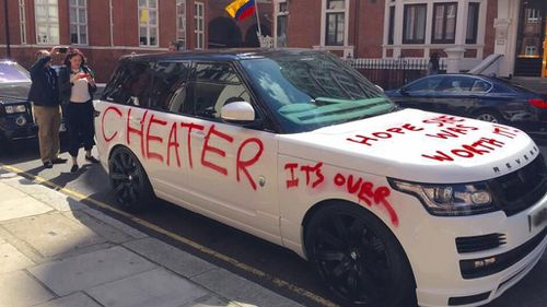 Seemingly scorned lover spray-paints luxury car with 'cheater' for all of London to see