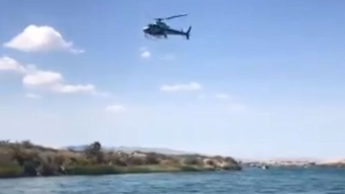Helicopters scoured the water after a boat collision in the Colorado River