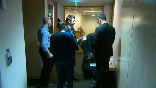 Homicide detectives stormed the law office on Castlereagh Street in Sydney's CBD just after 2pm this afternoon.