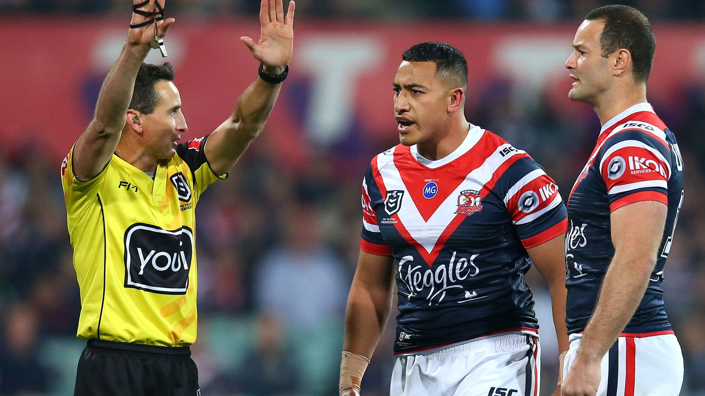 Siosiua Taukeiaho (C) of the Roosters is sent to the sin-bin by referee Gerard Sutton