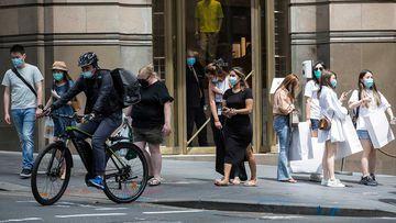 Shoppers wear masks on Castlereagh Street in Sydney.