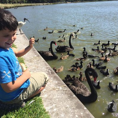Jo Abi son feeding ducks