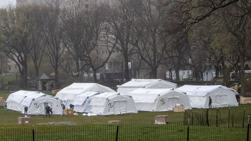 A Samaritan's Purse crew works on building a 68 bed emergency field hospital specially equipped with a respiratory unit in New York's Central Park.