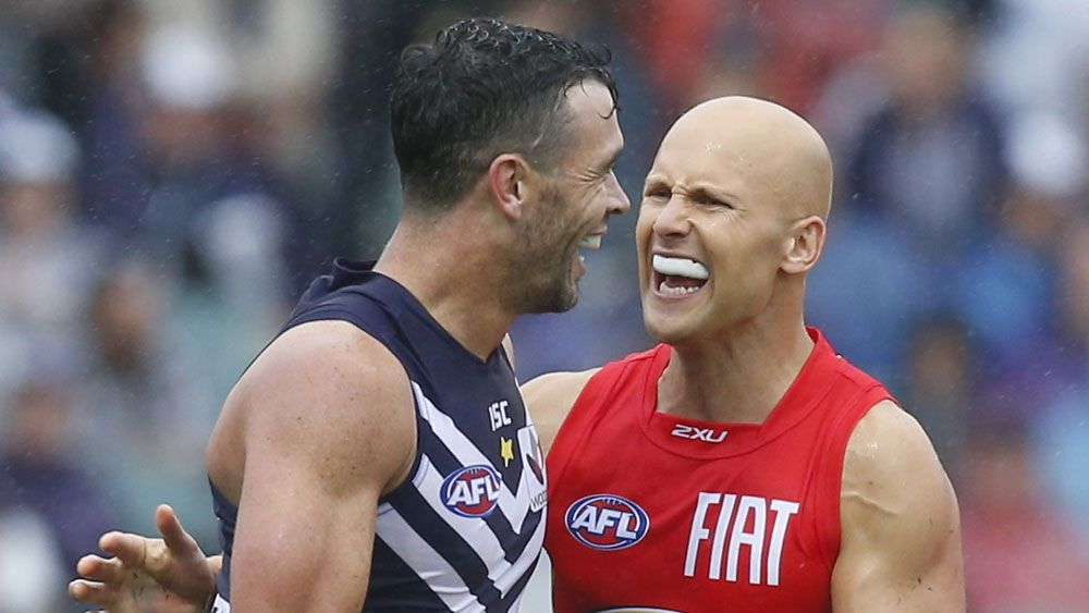 Ryan Crowley (l) and Gary Ablett. (AAP)