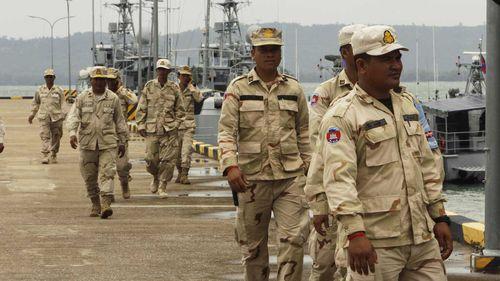 Cambodian navy troop members walk at Ream Naval Base in Sihanoukville, southwestern of Phnom Penh.