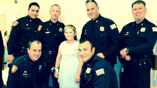 The officers said it was an honour to escort Jewel to the dance and a great way to keep Tim Warren's memory alive. (Memphis Police Department)