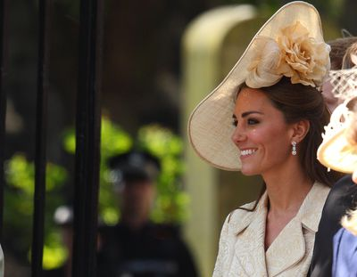 Kate also wore a large headpiece from Gina Foster Millinery's Jubilee collection.