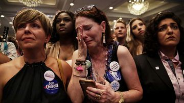 Dejected Jon Ossoff supporters weep as his defeat sets in. (AAP)