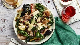 Kale salad with prosciutto, pumpkin seeds and cranberry balsamic vinaigrette