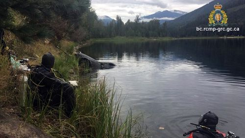 A Canadian dive team watches as Jane Farris' car is hauled from the bottom of Griffin Lake near Revelstoke, British Columbia. Police believe Farris ended up in the lake after swerving to avoid an animal or losing control of the Honda for some other reason.