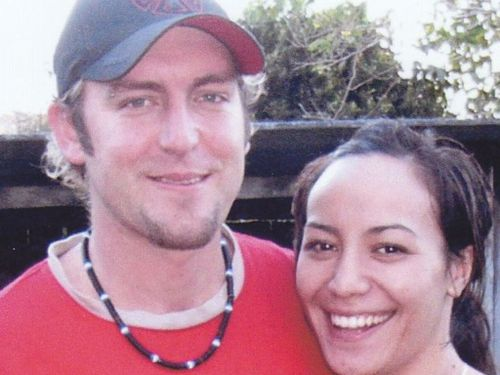 Omega Ruston, pictured with his partner Courtney, was shot dead on the Gold Coast Highway in 2009.