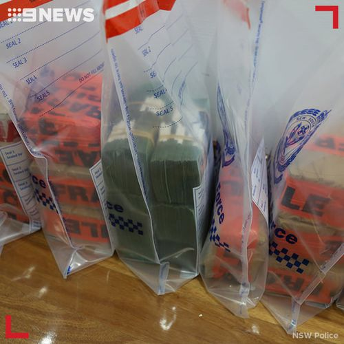 Four people have been charged after almost $6 million was allegedly found in the kitchen cupboards of a home in Sydney's southwest.