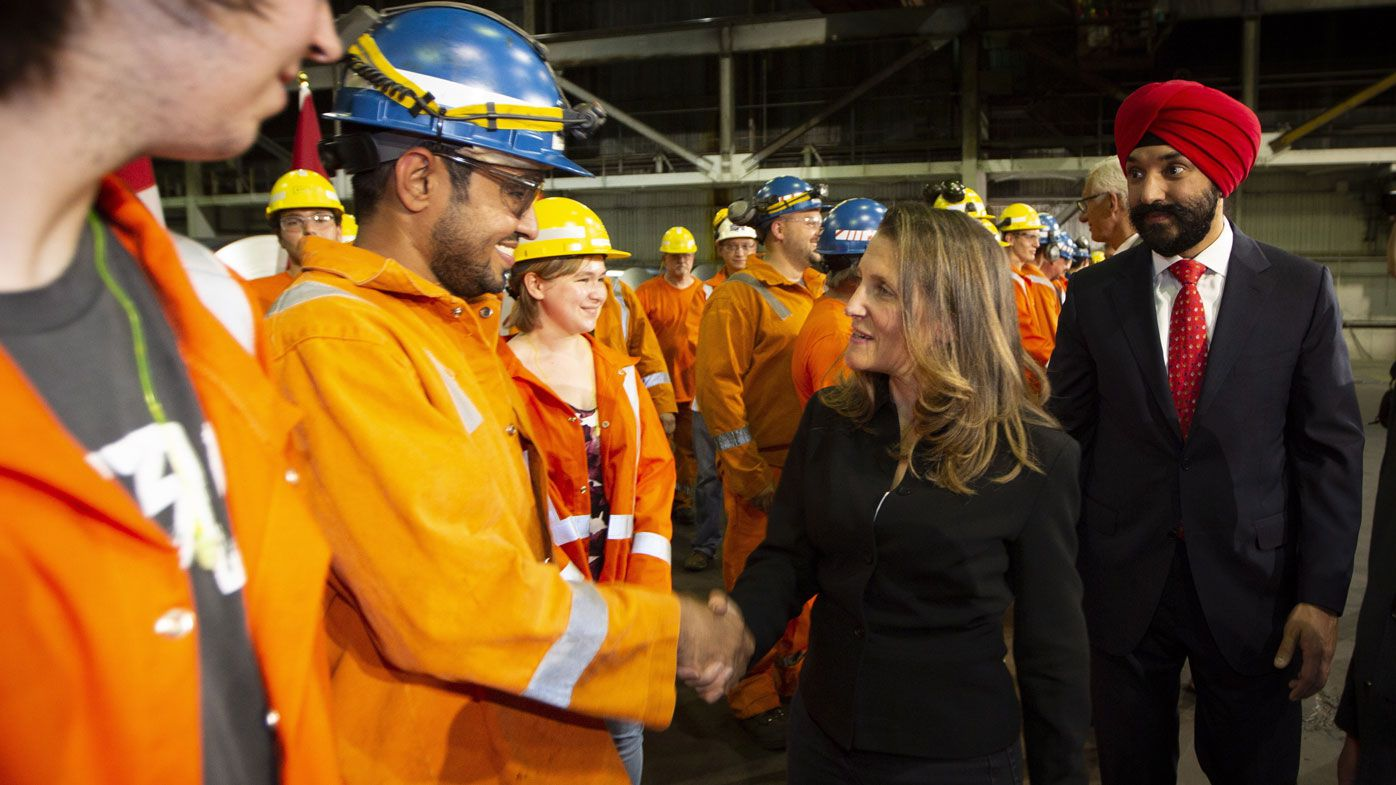 Canadian Foreign Minister Chrystia Freeland meets with steel workers. (AAP)