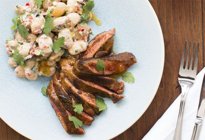 Butterfly leg of lamb with ras el haout and white bean salad