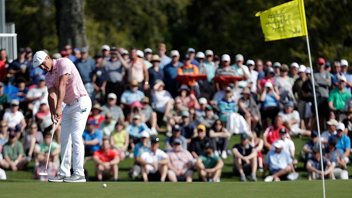 Bryson DeChambeau putts on the 17th green during the first round of The Players Championship
