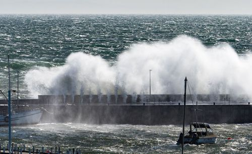 Wild waves blast over Mornington Pier this afternoon. Picture: Mark Spencer