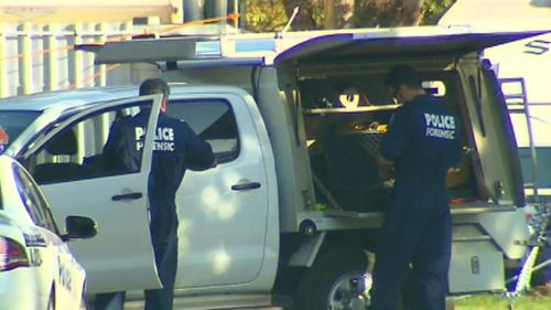 Police scouring the scene after the victim's body was found. Picture: 9NEWS