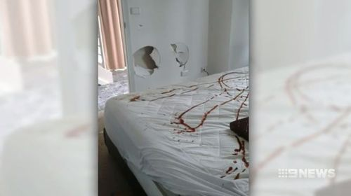Tomato sauce was sprayed on the bed.
