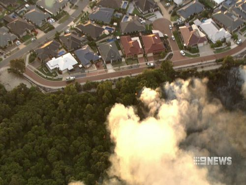 Cameras captured the fire burning dangerously close to homes yesterday afternoon. (9NEWS)