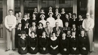 Woolworths Gosford staff pose for a photograph in 1956. (Supplied)