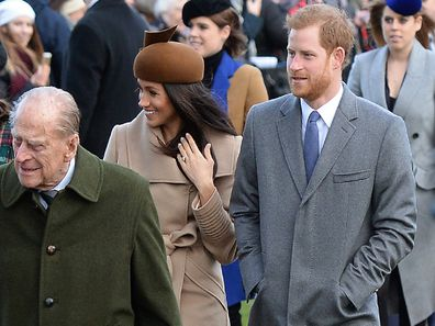 Prince Philip, Prince Harry and Meghan Markle leave Christmas Day service together.