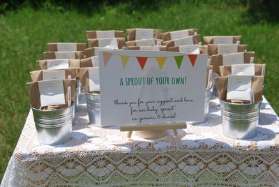 "<p>Baby Sprout Seed Pots</p> <p>A unique party favour for a baby shower is a <a href=""http://thesweetestdigs.com/the-diy-files-plant-pots-baby-shower-favours/"" target=""_blank"" draggable=""false"">seed in a pot</a> gift. Pop seeds in <a href=""https://www.spotlightstores.com/favours/loot-bags-boxes/party-loot-bag-10-pack/p/BP80234635"" target=""_blank"" draggable=""false"">small paper bags</a>, write on some <a href=""https://www.bunnings.com.au/gardman-127mm-plastic-tee-plant-label-50-pack_p2961057"" target=""_blank"" draggable=""false"">plant labels</a> and pop them in a little pot with some soil. You can buy <a href=""http://www.kmart.com.au/product/wire-basket-with-pots-set/699851"" target=""_blank"" draggable=""false"">six mini terracotta pots</a> in a wire carrier for $12 from Kmart.</p>"