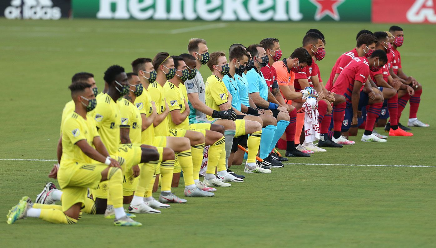 FC Dallas and Nashville kneel during the US national anthem at Toyota Stadium.