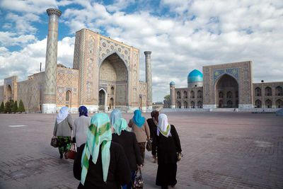 A group of women are walking towards the legendary Registan in Samarkand (Uzbekistan, 2016).