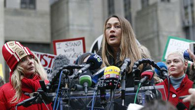 Dominique Huett, who says Harvey Weinstein sexually assaulted her, speaks at a press conference along with actresses Rosanna Arquette (L) and Rose McGowan (R) outside court on January 6, 2020 in New York City.