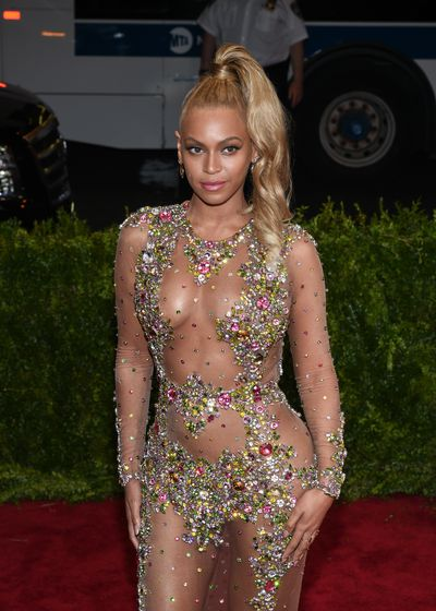 "<p>Beyonce at the 2015 Met Gala&nbsp;<em>China: Through The Looking Glass</em></p> <p><strong><em>How to create your own Jeannie 'Do</em></strong></p> <p><em></em>"" Start by coating the crown of the hair with a wet styling product like Schwarzkopf Professional&rsquo;s OSiS+ Big Blast,"" says Dee Parker-Attwood.</p> <p>""Then using a tail comb or brush, pull the hair into the correct position on the crown, making sure to remove any bumps and keeping tension on the hair. ""<em></em></p> <p>""To ensure that the look has a sleek finish, smooth once more and tie with an elastic hair tie.<br /> Finally to hold the look in place, lightly spray OSiS+ Session Label Super Dry Flex."" she added.</p>"