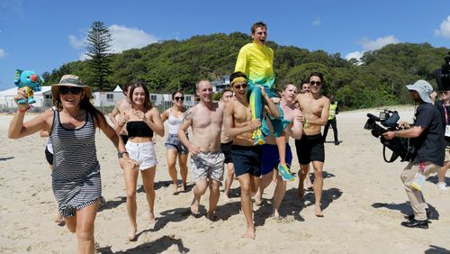 Dane Bird-Smith is carried into the ocean on the shoulders of his friends. (AAP)