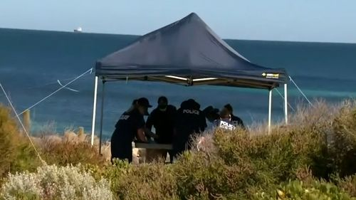 Police pictured at the iconic Perth beach today.