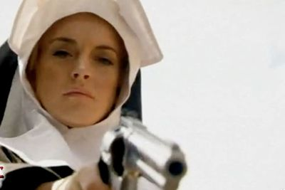 """In a bizarre """"career comeback"""", Lindsay was hired to star as a drug-abusing, spoiled wild child who wears a nun's outfit and blows bad guys to pieces in Robert Rodriguez's bloodfest <i>Machete</i>. Then in true controversial style, Lindsay didn't appear at the movie premiere."""