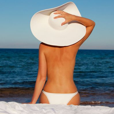 Woman told off for going topless on US beach